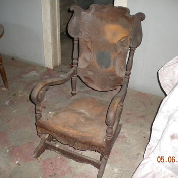 I need to know more about this antique rocker, please