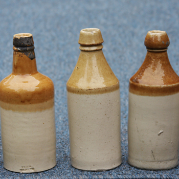 ---Tan and White beer bottles---