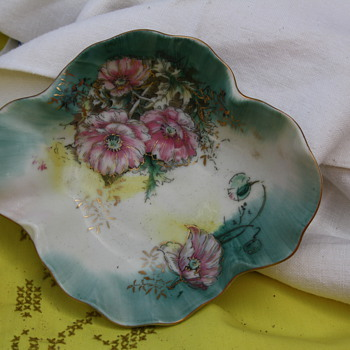 Plate looks like it could be handpainted with bottom markings