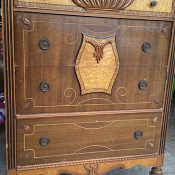 Highboy front detail on wheels dresser