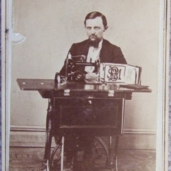 Salesman or Inventor with an early sewing machine