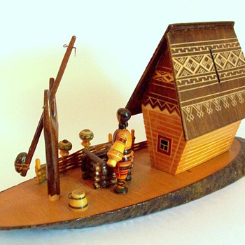 Carved wood bank with cottage scene Ukranian message on label