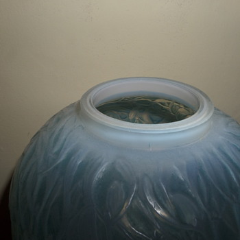 R Lalique cased Gui vase with blue stain.