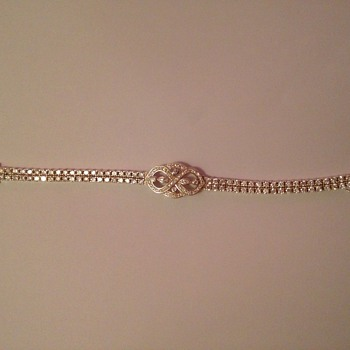 silver bracelets with over 85 cut  Cubic Zirconia stones I think