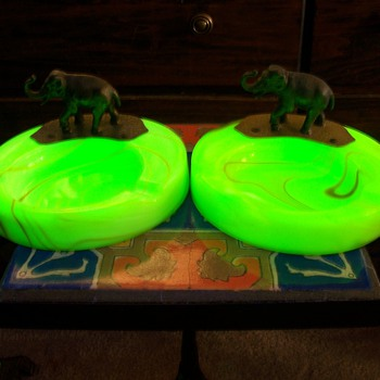 A pair of Houze Slag Glass Elephant Ashtrays