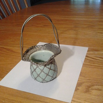 Antique green ceramic bowl in woven wire basket with handle