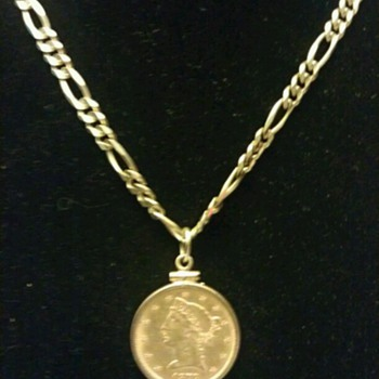 My gold chain with coin