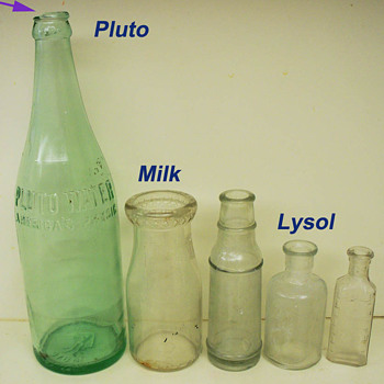 Five Glass Bottles:   Pluto Water,  Lysol,  Milk, + Two Unknowns
