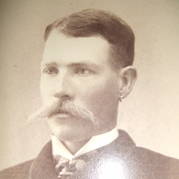 Cabinet card of dandy with large Moustache and earring