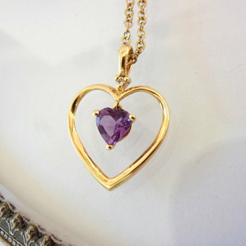 Heart pendants 14K with unknown makers marks???