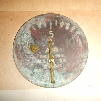 Instrument dial from early airplane crash