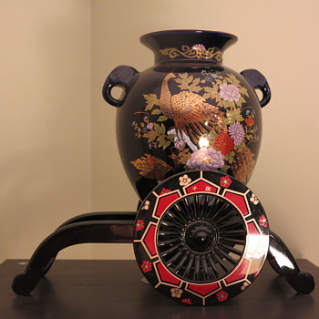 Japanese vase and plastic rickshaw