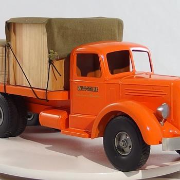 Smith Miller Orange Materials Truck