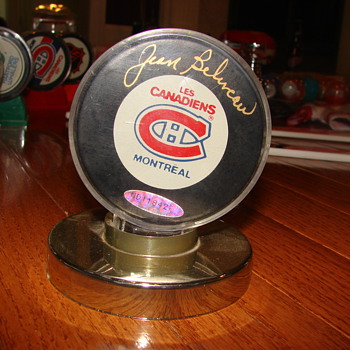 Jean Beliveau signed and numbered hockey puck.  - Hockey