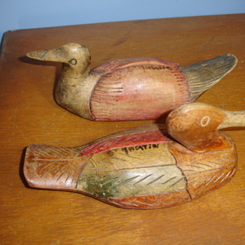 "2 vintage hand carved duck decoys ""signed"" are they rare?"