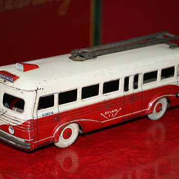 charles rossignol tin bus