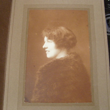Flapper girl with mink coat photograph in folder. - Photographs