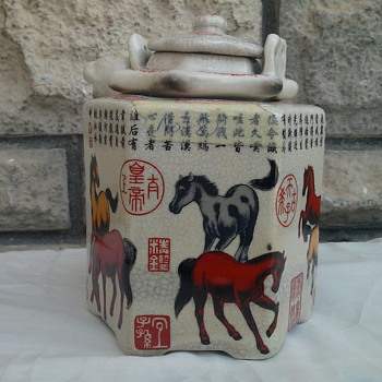 Early Chinese drink pot.