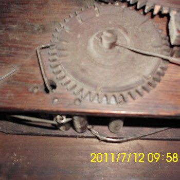 More old wooden clock works