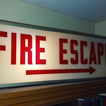 old lighted FIRE ESCAPE sign