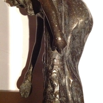 Broken bronze lady, possible once a lamp or water feature?
