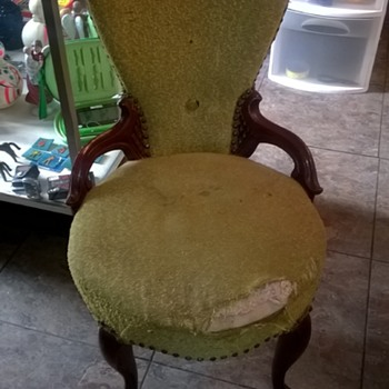 very old chair sits very low and has large springs covered in burlap on bottom