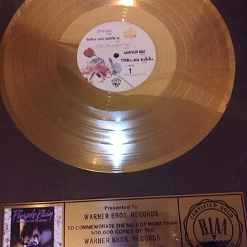 my Warner Brothers Gold record . - Music