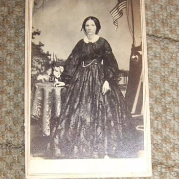 CDV of woman with Civil War backdrop - Photographs