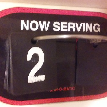 "TURN-O-MATIC ""NOW SERVING"" flip-sign"