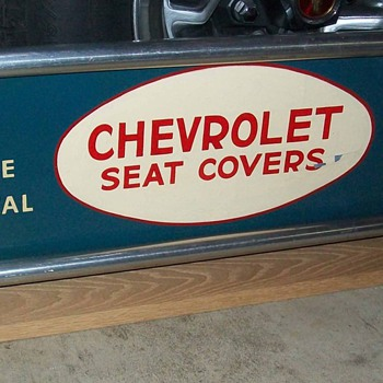 Chevrolet seat cover sign - Classic Cars