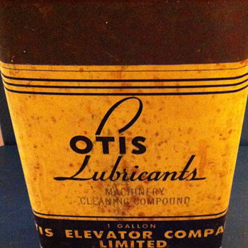 Three OTIS Lubricants can.