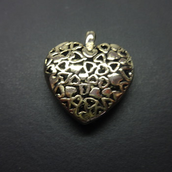 A VALENTINE'S HART-PENDIN OF ALL LITTLE HARTS INTO ONE BIG HART. - Fine Jewelry