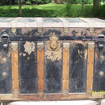 old steamer trunk. has an eagle lock.