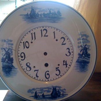 delft german porcelain with wind mills, wood octigone case wht. porcelain round front gustav becker clock.
