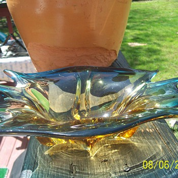 This is what I assume to be an ashtray from the 60's or 70's.  But it's gorgeous and has no marks. - Art Glass