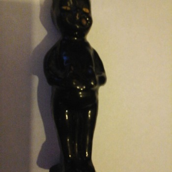 little black pottery figure