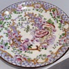 Antique small hand painted saucer
