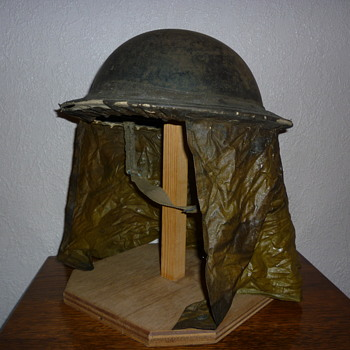 British WWII steel helmet with scarce rain cover - Military and Wartime
