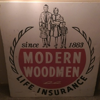 Im guessing a 1960's metal/tin modern woodmen life insurance company sign.  - Advertising