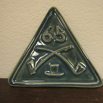 St. Pat's pipe-related Trivet?