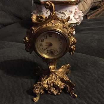 "antique clock.  appr. 5"" tall. wind up."