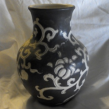 Clay vase with flower design
