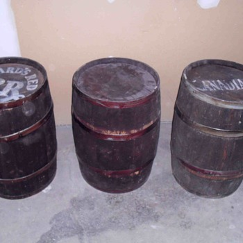 Three wooden barrels.