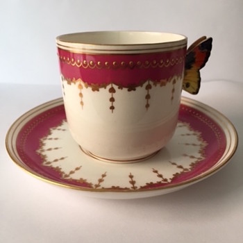 unmarked demitasse cup and saucer