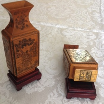 Pair of small Asian vases on pedestals