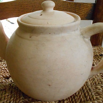 Mystery full size Teapot. Unglazed earthenware exterior. Glazed interior.