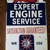 Sun service tin sign