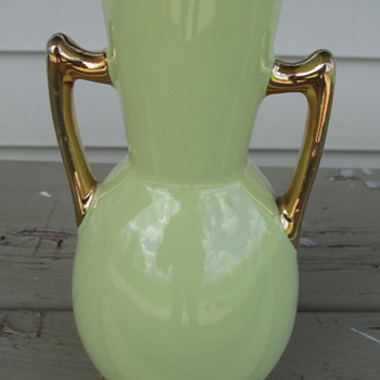 small green vase with gold trim