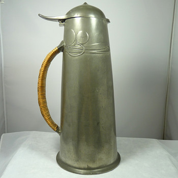 A Tudric Pewter 0304 Flagon by Archibald Knox for Liberty & Co