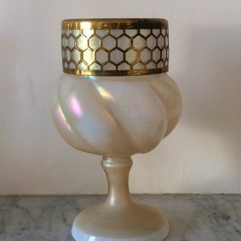 An unusual lobed mother of pearl footed urn